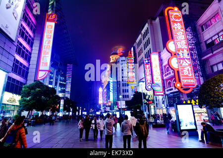 SHANGHAI, CN - MAR 17 2015:Visitors at Nanjing Road. It is the main shopping street of Shanghai, China, and is one - Stock Photo