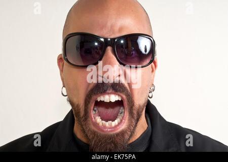 blacks man with glasses, beard and black jacket - Stock Photo