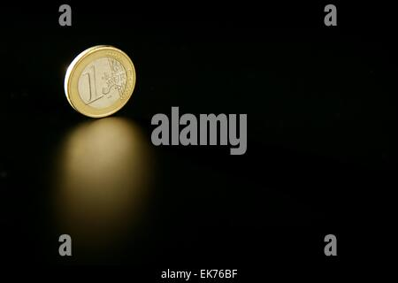 Euro currency coin macro with reflection - Stock Photo