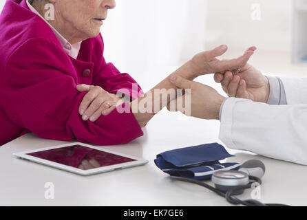 Auscultation senior woman - Stock Photo