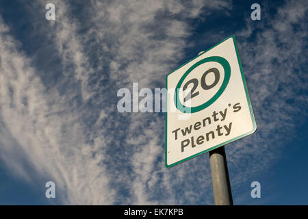 A perspective view of a Twenty's Plenty speed restriction sign with dramatic clouds in the background. Glasgow, - Stock Photo