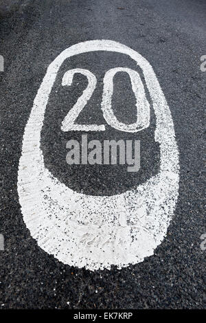 A 20mph speed restriction painted on the road in white paint. Glasgow, Scotland, UK - Stock Photo