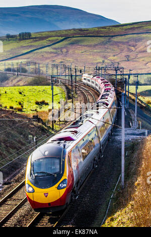 Power lines, and gantries for electric trains at Cumbria, UK 8th April, 2015.  UK Weather.  Bright Sunny day over - Stock Photo