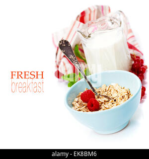 healthy breakfast with bowl of oat flakes - Stock Photo