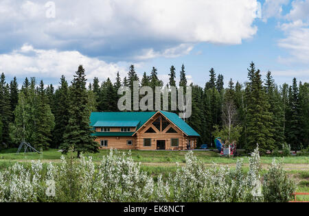 Modern log cabin home on the bankof the Chena River, Fairbanks, Alaska, USA - Stock Photo