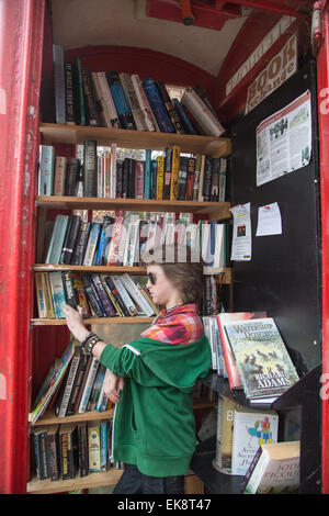 K6 Red telephone box, designed by Sir Giles Gilbert Scott,used as a lending library in a Suffolk village - Stock Photo
