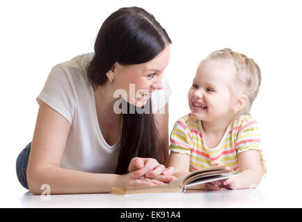mother teaches reading book to kid Stock Photo