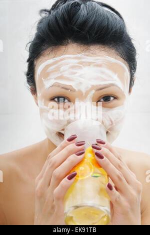 Beauty mask and juice - Stock Photo