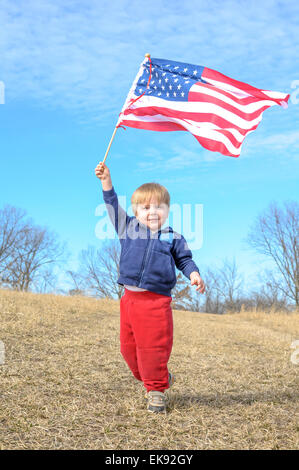 Young child waves the American flag - Stock Photo