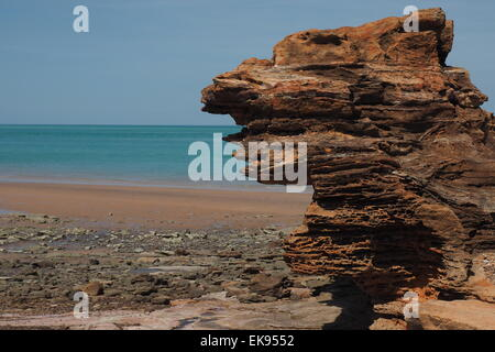 Pindan red rocks and beach near port of Broome, Western Australia. - Stock Photo