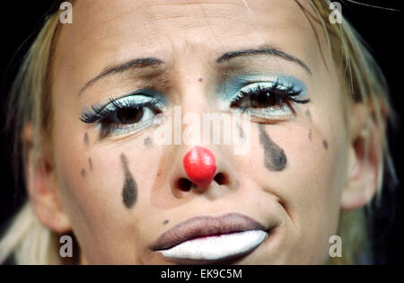 Tears of a Clown - Female clown Andrea Santos looks miserable on the main stage of the Cottle and Austen Electric - Stock Photo