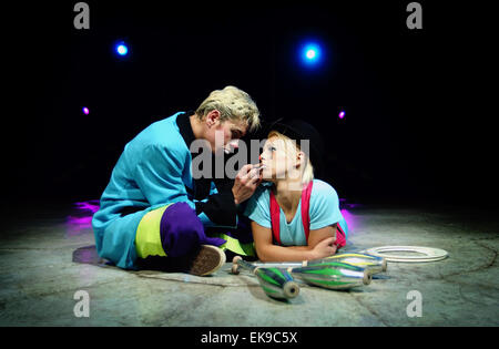 Female clown Andrea Santos has tears painted onto her cheeks by husband Emilion on the main stage  of the Cottle - Stock Photo