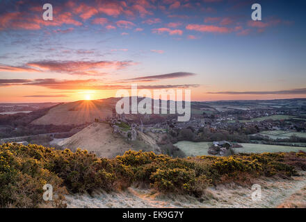 Beautiful dramatic sunrise over Corfe Castle in Dorset - Stock Photo
