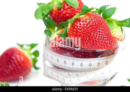 big juicy red ripe strawberries in a glass bowl isolated on whit - Stock Photo