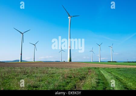 Windwheels in the fields seen in rural Germany - Stock Photo