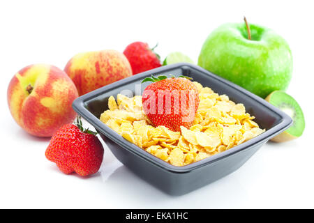strawberry, peach, apple, kiwi and flakes in a bowl isolated on - Stock Photo