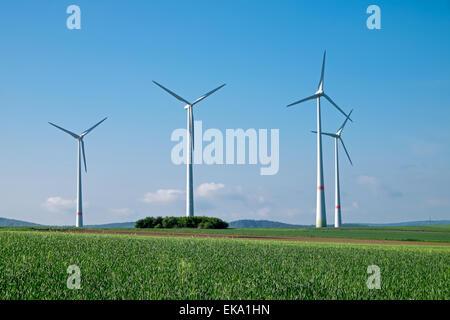 Windwheels under a blue sky, seen in rural Germany - Stock Photo
