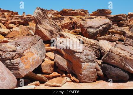 Pindan red rocks at Gantheaume Point Broome, Western Australia. - Stock Photo
