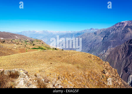 View of the arid land around Colca Canyon in Peru - Stock Photo