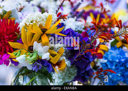 Beautiful bright bouquet of sunny summer flowers. - Stock Photo