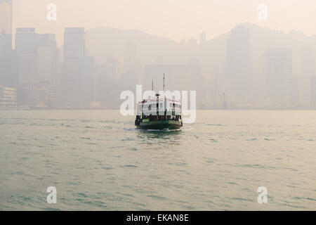 Hong Kong Star Ferry on a smoggy Hong Kong Day - Stock Photo