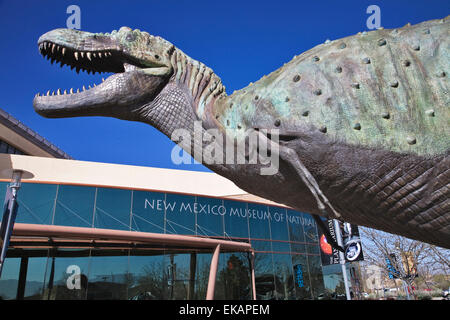 A giant green skinned raptor greets visitors at the entrance to the New Mexico Museum of Natural History & Science. - Stock Photo