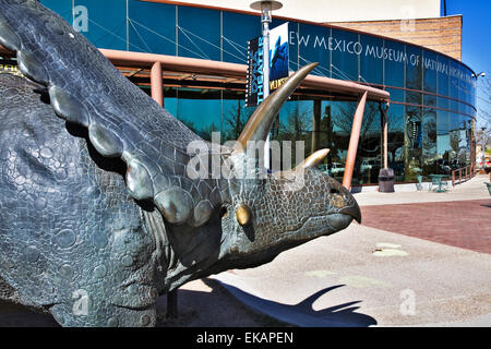 A large bronze Triceratops welcomes visitors to the New Mexico Museum of Natural History & Science in Albuquerque. - Stock Photo
