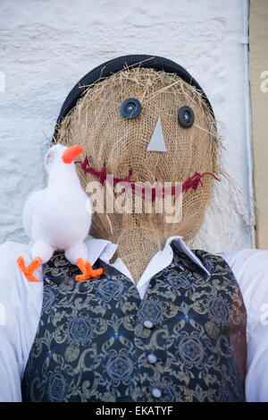 Scarecrow at scarecrow festival. Smiling scarecrow with duck on shoulder. - Stock Photo