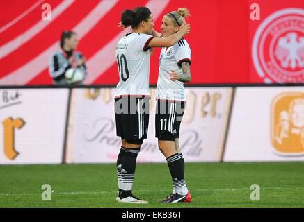 Germany's Dzsenifer Marozsan (L) and Anja Mittag cheer after Marozsan's 4-0 goal during  the women's international - Stock Photo
