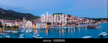 Elevated view over the picturesque harbour town of Hvar illuminated at dusk, Hvar, Dalmatia, Croatia, Europe - Stock Photo