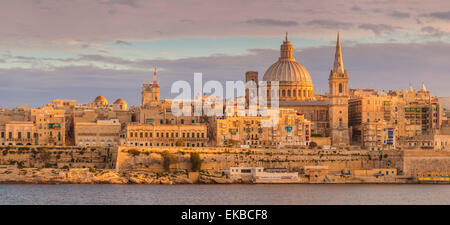 Valletta skyline panorama at sunset with the Carmelite Church dome and St. Pauls Anglican Cathedral, Valletta, Malta - Stock Photo