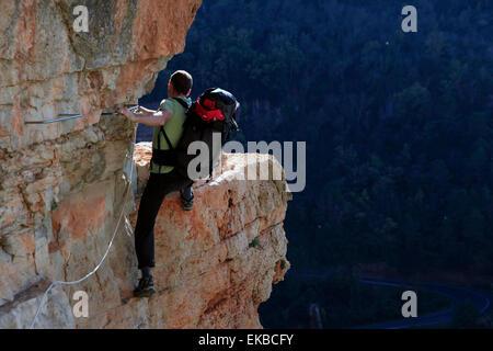 A climber scaling a Via Ferrata at Siurana, Catalonia, Spain, Europe
