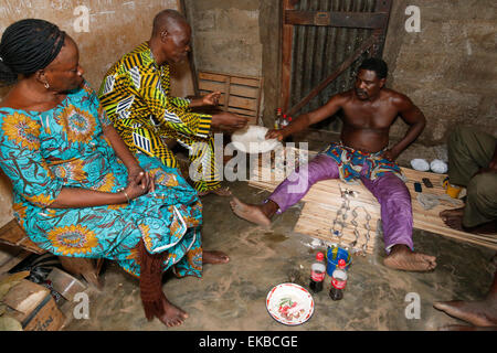 Couple visiting a fortune teller in Ouidah, Benin, West Africa, Africa - Stock Photo