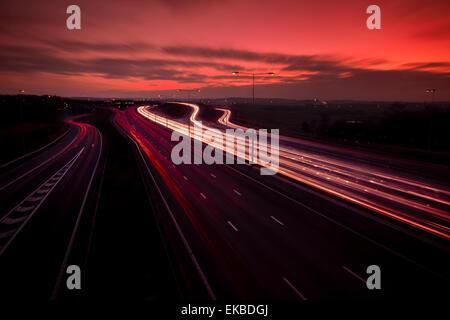 M25 motorway light trails at Dartford Crossing under dramatic sky, Kent, England, United Kingdom, Europe - Stock Photo