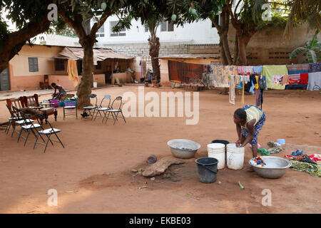 African woman doing the dishes, Lome, Togo, West Africa, Africa - Stock Photo