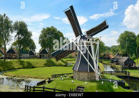 Traditional Dutch windmill, Zuiderzee Open Air Museum, Lake Ijssel, Enkhuizen, North Holland, Netherlands, Europe - Stock Photo