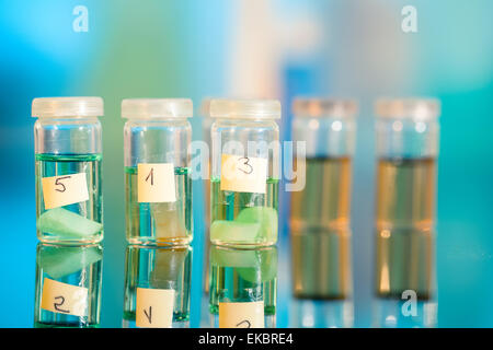 Three samples in plastic vials for microscopy and biopsy tissue - Stock Photo