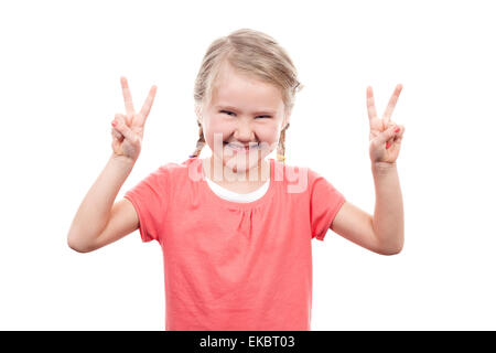cute girl showing victory sign - Stock Photo