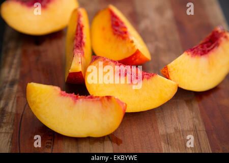 Peach slices on cutting board - Stock Photo