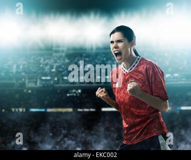 Footballer celebrating goal - Stock Photo