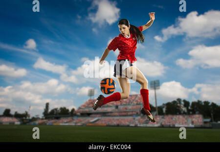 Footballer trying back heel - Stock Photo