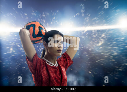 Footballer throwing in - Stock Photo