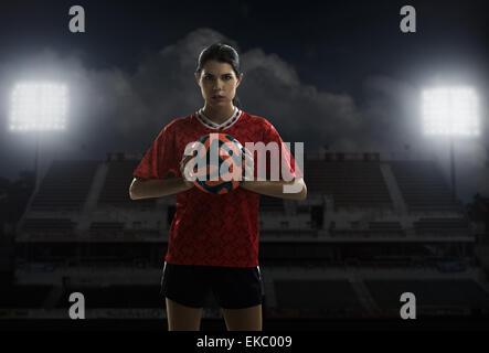 Footballer holding ball - Stock Photo