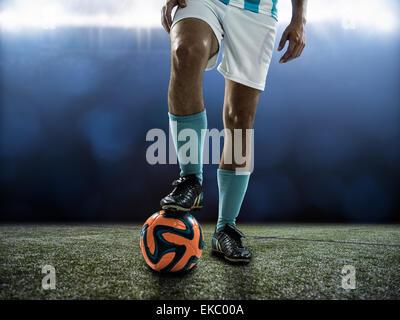 Footballer waiting for kick off - Stock Photo