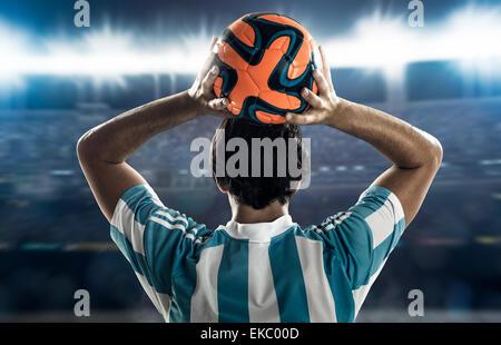 Footballer throwing in - Stock Photo