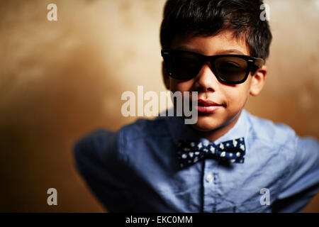 Boy wearing sunglasses and bow tie - Stock Photo