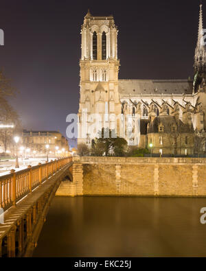 View of Notre Dame Cathedral and Pont au Double at night, Paris, France - Stock Photo