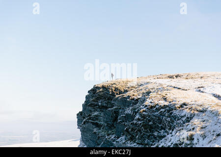 Woman standing on outcrop, Llyn y Fan Fach, Brecon Beacons, Wales - Stock Photo