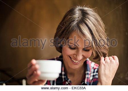 Woman having coffee break - Stock Photo
