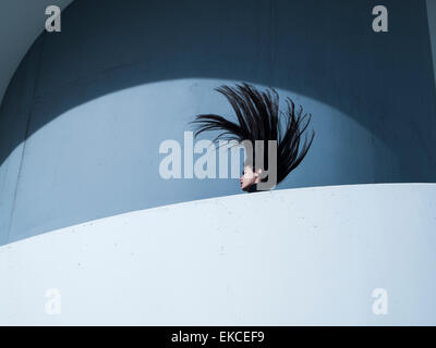 Young woman throwing her head back - Stock Photo